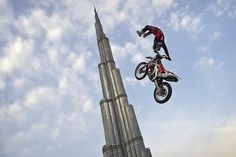 Dubai's Burj Khalifa is, at 2,723 feet, the world's tallest building. Here, FMX athlete Josh Sheehan isn't quite clearing that height, but the location and perspective makes for a stunning photo.  From HellforLeathermagazine.com