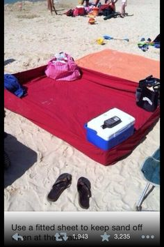 Use a fitted sheet to keep the sand out of your stuff at the beach!