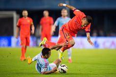 Neymar Santos Jr of FC Barcelona is brought down by Fabian Orellana of Celta Vigo during the La Liga match between Celta Vigo and FC Barcelona at Estadio Balaidos on April 5, 2015 in Vigo, Spain.