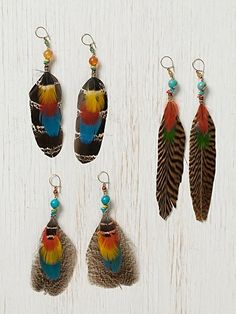 Love feather earrings ... these colors are gorgeous .