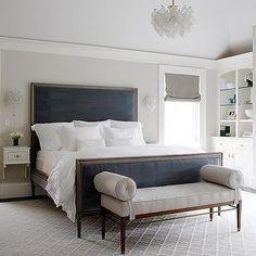 Lovely an elegant Bachelorette bedroom with navy velvet sleigh bed sexy white linens...
