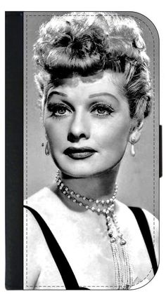 Lucille Ball (Lucy) © PU Leather Apple iPhone 6 Plus, 6s Plus Wallet Case. Quality Leather-Look Wallet Case with Flip Cover and Magnetic Clasp Compatible with the Apple iPhone 6 Plus/6+/6s Plus/6s+ (NOT COMPATIBLE WITH THE STANDARD IPHONE 6 OR 6S). Bright, Eye-Catching Flat-Printed Image on Metal Substrate with Glossy Finish. Made and Manufactured in the U.S.A. Excellent Customer Service! Great Gift Idea!. As the sole manufacturer of this Item, Lea Elliot Inc. does not take responsibility...