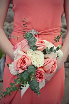 Silk coral bridesmaids with cream & coral roses