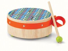 Manhattan Toy Beat Bop Drum by Manhattan Toy. $19.95. Toddlers can use mallet or their hands. Classic first instrument. Made of rubberwood with non-toxic finish. From the Manufacturer                This wood drum comes with a wide range of tones. Slap or tap the bright surface to drum up some cool sounds. Comes with convenient carry handle, scratch-free rubber-tipped base, and fabric loop to store mallet.                                    Product Description                Thi...