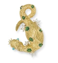 GREEN TOURMALINE, TURQUOISE AND DIAMOND SALAMANDER BROOCH, BY JEAN SCHLUMBERGER, TIFFANY & CO. The textured gold body enhanced by rectangular-cut green tourmalines, with circular-cut diamond feet and cabochon turquoise eyes, extending polished gold whiskers, mounted in 18k gold and platinum Signed Tiffany, Schlumberger