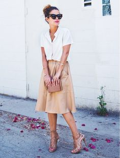 White short-sleeved button-down, tan skirt, tan heels, brown clutch, and sunglasses