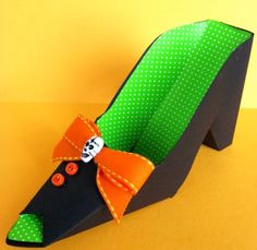 How To Make Paper Witch Shoes - by Skip To My Lou    ==            A very nice papercraft project for Halloween: Paper Witch Shoes that can be used like candy boxes. And you can change the decoratrion, to use it in birthday parties, Christmas, etc. This very nice and easy project is from Skip To My Lou website.