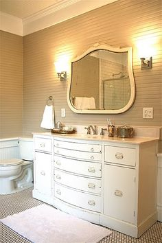 Adore the planking on the wall and the dresser used as a sink is very cool
