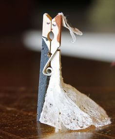 Clothes pin couple, bride and groom; cute for a wedding shower favor party decor; upcycle, recycle, repurpose, salvage, diy!  For ideas and goods shop at Estate ReSale & ReDesign, Bonita Springs, FL