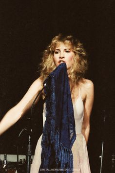 Stevie ~ ☆♥❤♥☆ ~ onstage during her 'Bella Donna' tour with her blue Bella Donna shawl draped over her microphone stand ~ 'Bella Donna' is Stevie's debut studio album and was released on July 27th, 1981 ~ https://en.wikipedia.org/wiki/Bella_Donna_(album)