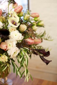 Gorgeous centerpiece with deep dark callas - switch the tones around to match your own holiday colors