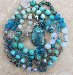 A gorgeous 925 Sterling silver Copper Turquoise Pendant adorns this long hand knotted necklace. I have designed this necklace with double silk, for those who prefer a little more pronounced knots. This necklace will last forever. Lure of the Sea in Deep Ocean Turquoise Colors, Hand made