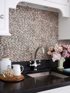 Stacked pebble backsplash
