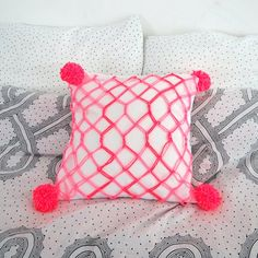 Make a cute macrame cushion to add a pop of color!