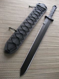 """Miller Bros. Blades Custom M-16 Tactical Sword. 24"""" Blade, Double Handed, Kydex sheath. This sword has a custom tip profile and jimping on the spine near the handle."""