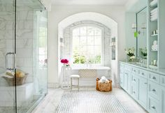 A Dream-worthy Bathroom - love the mix of white materials and soft turquoise/aqua cabinetry