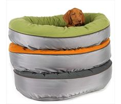 "Don't leave Fido out on your mission to Go Green.  Give him a comfortable place to rest with an Eco Orbit Pet Bed.  This pet bed is lined with a soft ""Eco-Tech"" polar fleece lining for warmth and comfort.   The exterior, made from a tough, waterproof nylon helps keep the bed clean and dry.  The cushion is designed to provide excellent support for larger dogs or older dogs with arthritic joints.  The bolster and cushion cover are both machine washable making this pet bed ideal for use just…"