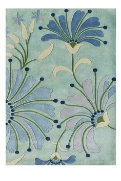 Gorgeous floral rug with pops of lavender, light blue and dark green against an aqua background. Love!