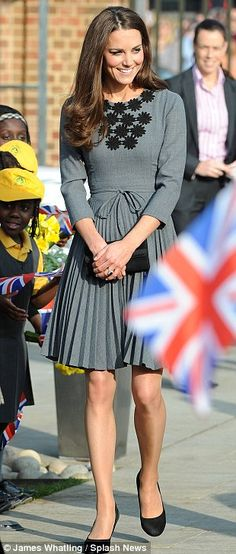Kate wore a sophisticated pleated grey dress by Irish designer Orla Kiely.