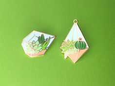 One terrarium enamel pin, perfect for succulent and cacti enthusiasts. This pin is a companion to my original terrarium pin ( http://etsy.com/listing/385610602 ). An alternate garden at night version is available black and pastel: http://etsy.com/listing/504524675.  - THE NITTY GRITTY - ✎ One 1.25-inch (32mm) hard enamel pin, made from my original illustration ✎ Shiny gold metal ✎ One rubber pin back ✎ OH PLESIOSAUR stamped on reverse  - PACKING & S...