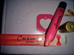 Cherimoya lip crayon in coral *swatched *