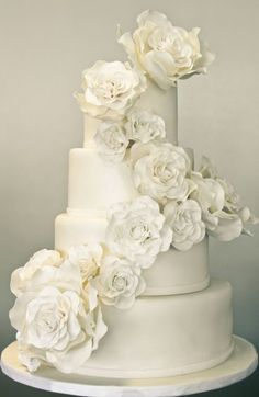 Fondant and gumpaste rose cascade.  http://www.theexcitedbride.com/2012/08/23/10-wedding-cakes-to-inspire-you/