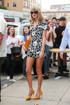 Taylor leaving a gym in New York City on May 17, 2014 wearing a Suno romper, Gucci pumps,mand Derek Cardigan sunglasses with an Anthropologie bag. LOVE!!!!