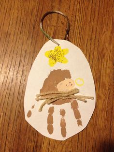 Abby's baby Jesus in a manger handprint Christmas ornament