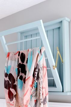 Hinges Small Space Storage Tip and DIY Ideas | This DIY drying rack (which only cost $30) uses locking hinges to keep the rack nice and stable.