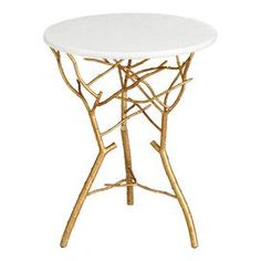 Gold leaf-finished iron side table with a branch-inspired base and granite top.Product: End table   Construction Material: Iron and granite       Color: Gold and whiteFeatures:  Delicate branch-inspired legsTransitional style  Will enhance any dcor              Dimensions: 23.25 H x 19 Diameter