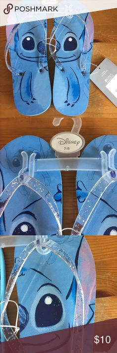 LILO and stitch glitter strap women's flip flops Cute blue stitch sandals with clear glittered straps. NWT. Size 7/8 women's . All Disney products are genuine. Disney Shoes Sandals