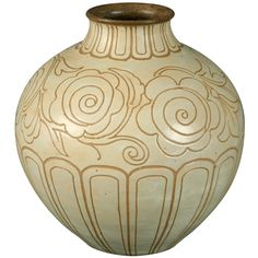 French Art Deco Period Vase by Georges Serre >>> c. 1920s  Exquisite French art deco period stoneware vase by Georges Serre (1889-1956.) Deeply incised with floral and geometric motif. Signed on bottom.