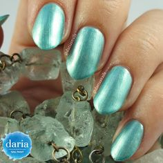 A new color from my first nail polish collection: Mermaid's Jewels. It's a subtle blue-green with gold shimmer in it. I saw something similar in Channel and OPI colors after I created this one. Seems like a new trend, right? :)