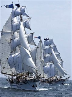 "The twin brigantines, ""Irving Johnson"" and ""Exy Johnson"", under full sail."