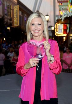 """Flamingo Las Vegas Headliner Olivia Newton-John Lights the High Roller Pink with Chippendales and Breast Cancer """"Thrivers"""" (Photo credit: Denise Truscello / WireImage / www.DeniseTruscello.net)."""