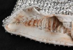 Michael´s famous glove -  You can clearly see make-up stains on the inside of it. Michael used make-up to blend out his skin-tone, and to cover up the the white patches on his skin, due to vitiligo.