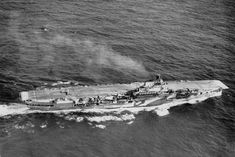 HMS Indomitable seen in late 1941 or early 1942.
