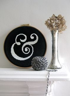 Needlepoint ampersand on black