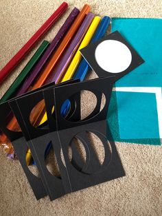 """DIY camera lens filters with colored cellophane and cardboard """"frames."""""""