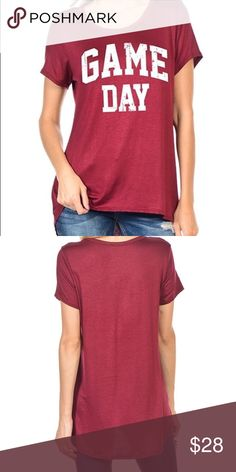 Burgundy game day tee Our game day tee is an awesome stretchy material and long enough in the back to wear with leggings! Tops Tees - Short Sleeve