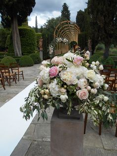 blush pink ceremony arrangement with peonies, roses and hydrangeas