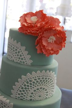 sage, white lace, and salmon wedding cake
