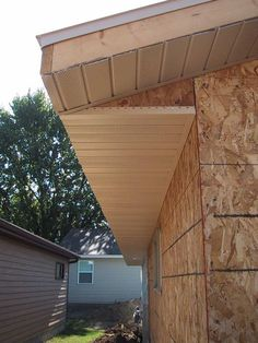 Save money and time when installing soffit, the exposed siding underneath your roof's overhang. Shed Design, Roof Design, House Design, Exterior House Siding, Exterior Trim, Vinyl Soffit, Roof Soffits, Vinyl Siding Installation, Soffit Ideas
