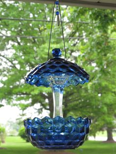 cobalt blue glass sugar bowl with lid and a glass candle stick--instant bird feeder. Easy to make!