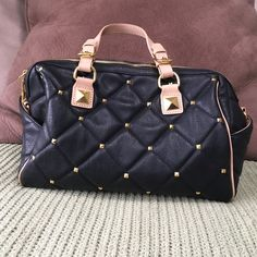 fashion bag Fashion bag good condition black with gold studs on one side. Quilted type look  , tan straps no wear on bottom separation pocket inside along with your normal pockets inside one small pen mark shown in picture no wear or tear or marks Bags Shoulder Bags