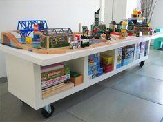 LACK shelving unit + door + casters = train table