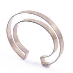 negative spaced cuff - white brass. $92.00, via Etsy.