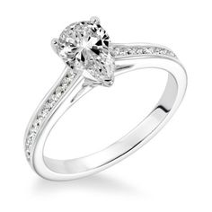 White Gold Channel Set Engagement Ring displayed with a pear cut diamond in the center Engagement Rings Channel Set, Pear Shaped Engagement Rings, Pear Diamond Rings, Diamond Ring Settings, Ring Displays, Wedding Rings, Wedding Engagement, Jewelry Shop, White Gold