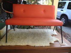 Orange vinyl bench mid century