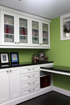 craft room with built-in desk and tons of storage Love the green too.
